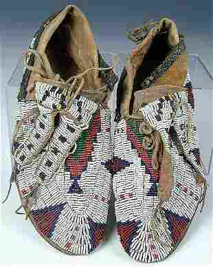 A GOOD PAIR OF MENS SIOUX BEADED MOCCASINS, c.190