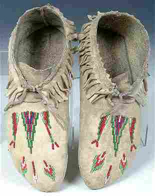 A PAIR OF MENS SHOSHONE BEADED MOCCASINS c.1940.