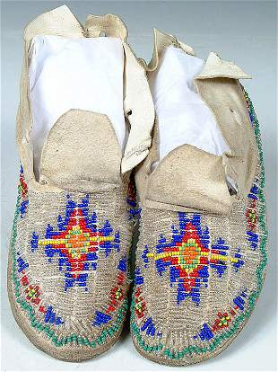 A PAIR OF CHILDRENS CHEYENNE BEADED MOCCASINS c.1