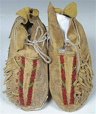 A PAIR OF CHILDRENS COMMANCHE BEADED MOCCASINS wi