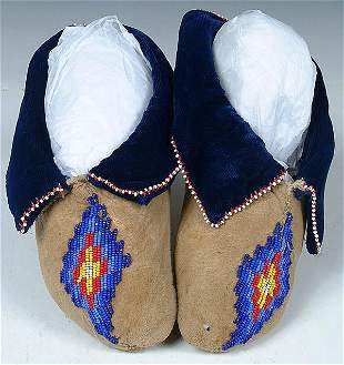 A PAIR OF CHILDRENS OSAGE BEADED MOCCASINS, hole
