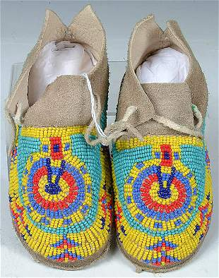A PAIR OF CHILDRENS CHEYENNE BEADED MOCCASINS, c.