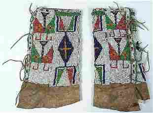 A PAIR OF CHILDRENS SIOUX BEADED LEGGINGS C.1890.