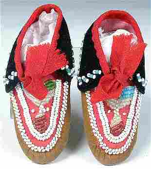 A PAIR OF INFANTS IROQUOIS BEADED MOCCASINS, c.19