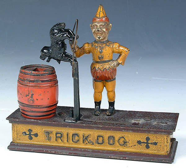 "500: A VERY FINE MECHANICAL BANK ""TRICK DOG"" by Hubley"