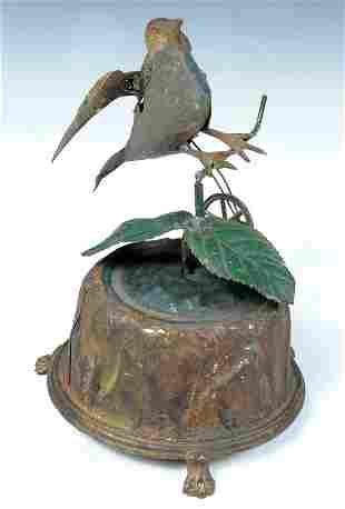 A FINE 19TH C WIND UP TOY BIRD moves around on tr