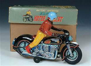 A FINE BATTERY OPERATED MOTORCYCLE by Modern toys