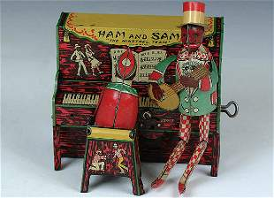 A HAM AND SAM TIN WINDUP toy. Very good condition