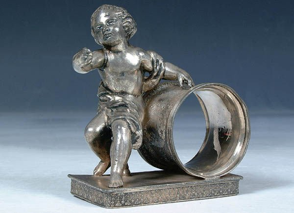 838: A GOOD VICTORIAN FIGURAL SILVERED NAPKIN RING of