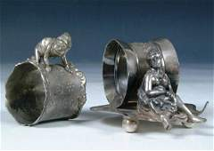 840: A PAIR OF VICTORIAN FIGURAL SILVERED NAPKIN RINGS