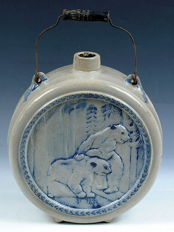 1162: A BLUE GRAY SCENIC BEAR EMBOSSED STONEWARE JUG of
