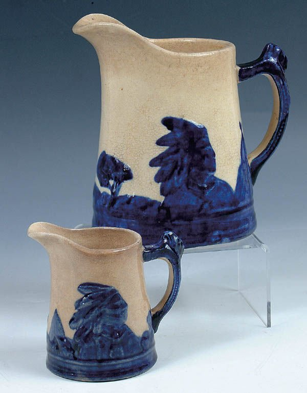 """1166: A PAIR OF """"SLEEPY EYE"""" STONEWARE PITCHERS with co"""
