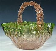 1457: A FINE VICTORIAN GLASS BASKET in pink threaded gl