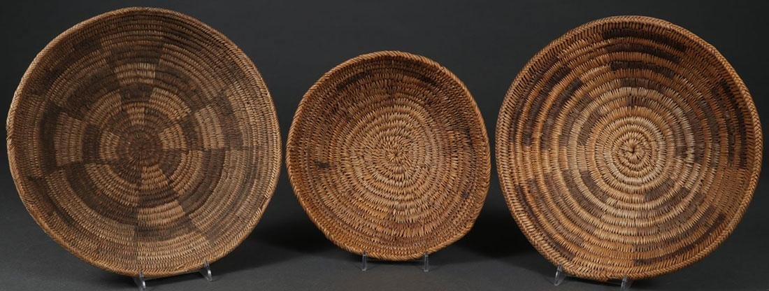 A GROUP OF THREE NAVAJO BASKETS, CIRCA 1900