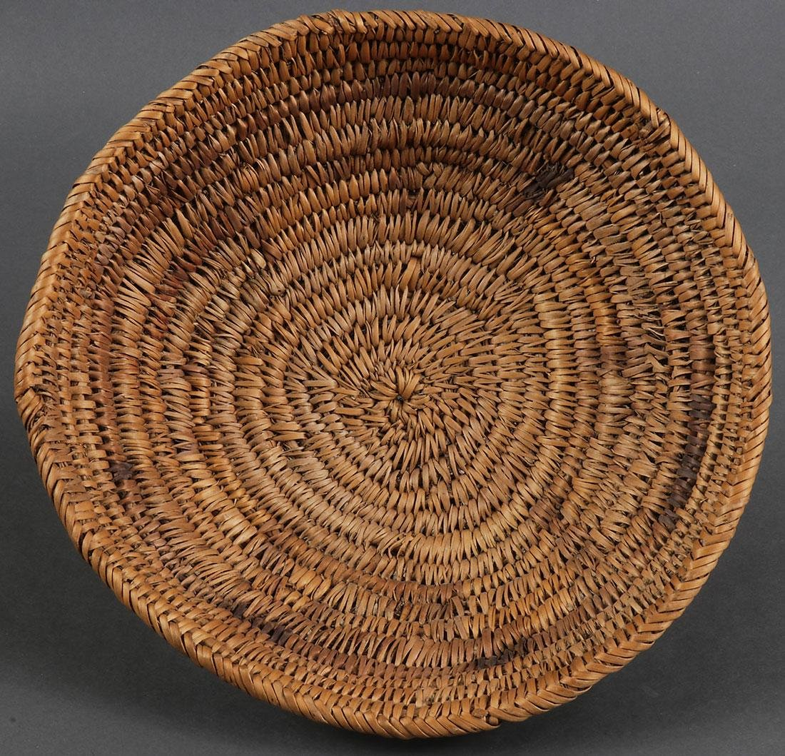 A GROUP OF THREE NAVAJO BASKETS, CIRCA 1900 - 2