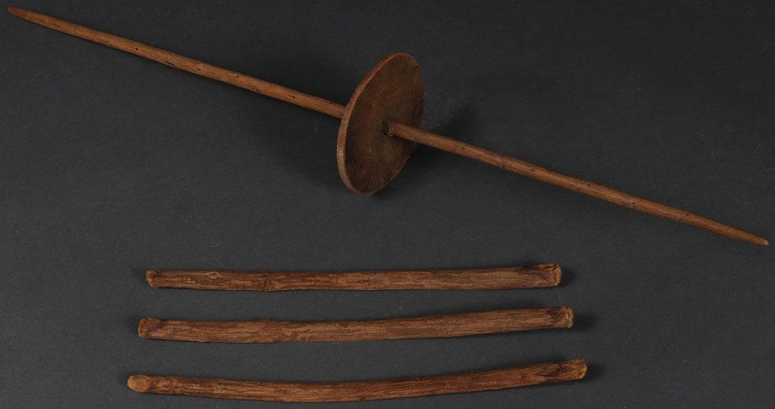 A HOPI SPINDLE STICK AND APACHE GAMBLING STICKS