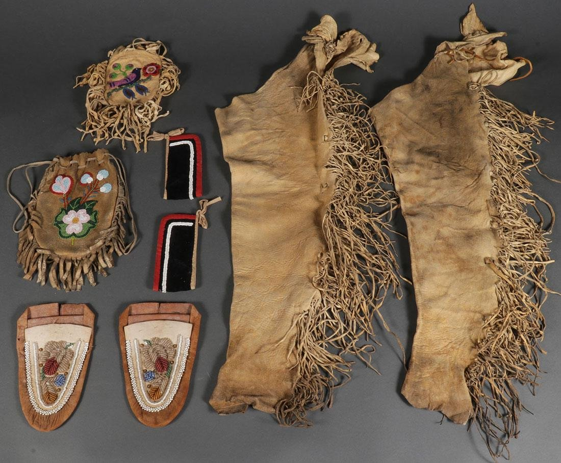 A GROUP OF NATIVE AMERICAN BEADED HIDE ITEMS
