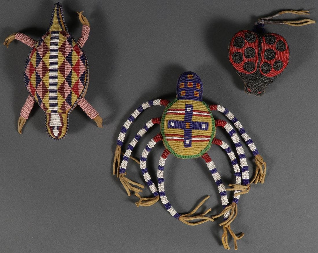 THREE PLAINS STYLE BEADED EFFIGY FETISHES