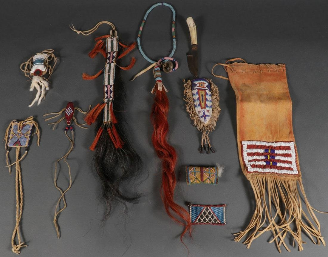 A GROUP OF NINE NATIVE AMERICAN BEADED ITEMS