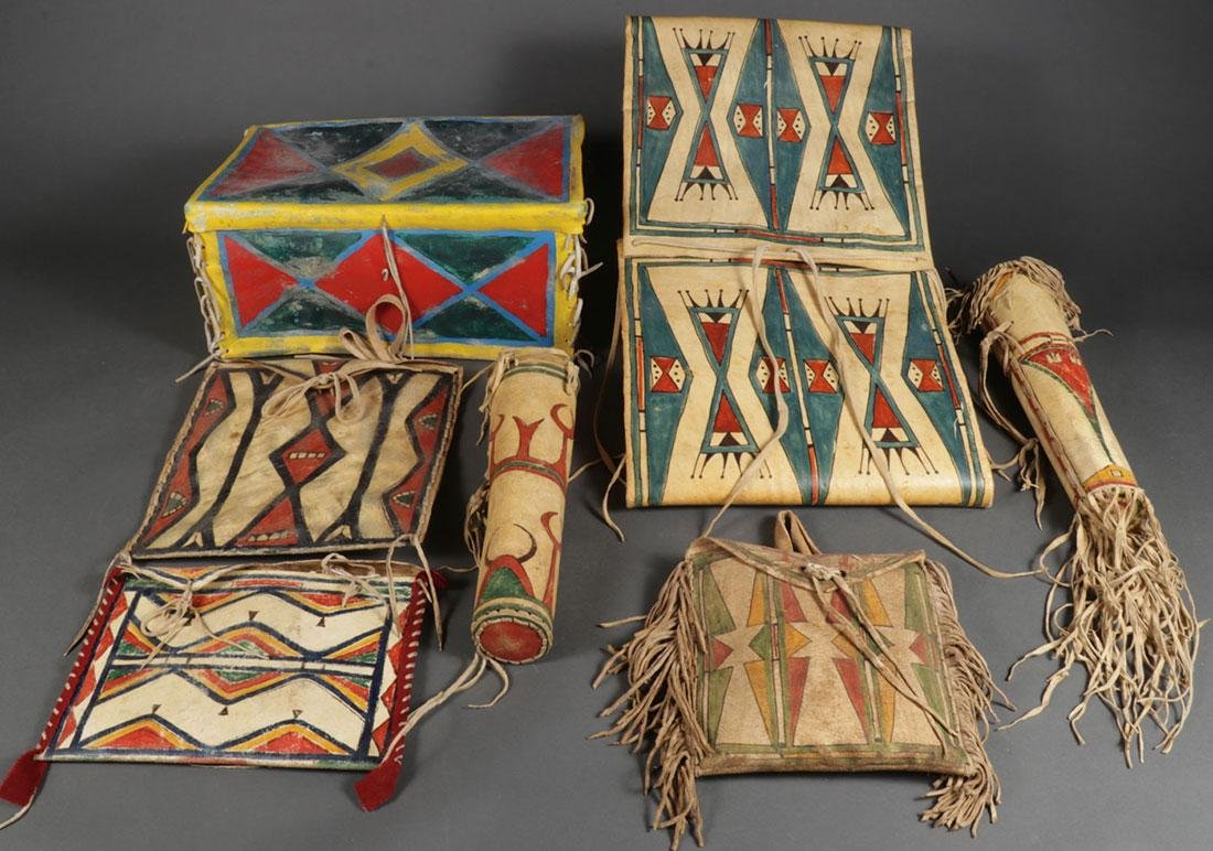 A GROUP OF POLYCHROME PARFLECHE CONTAINERS