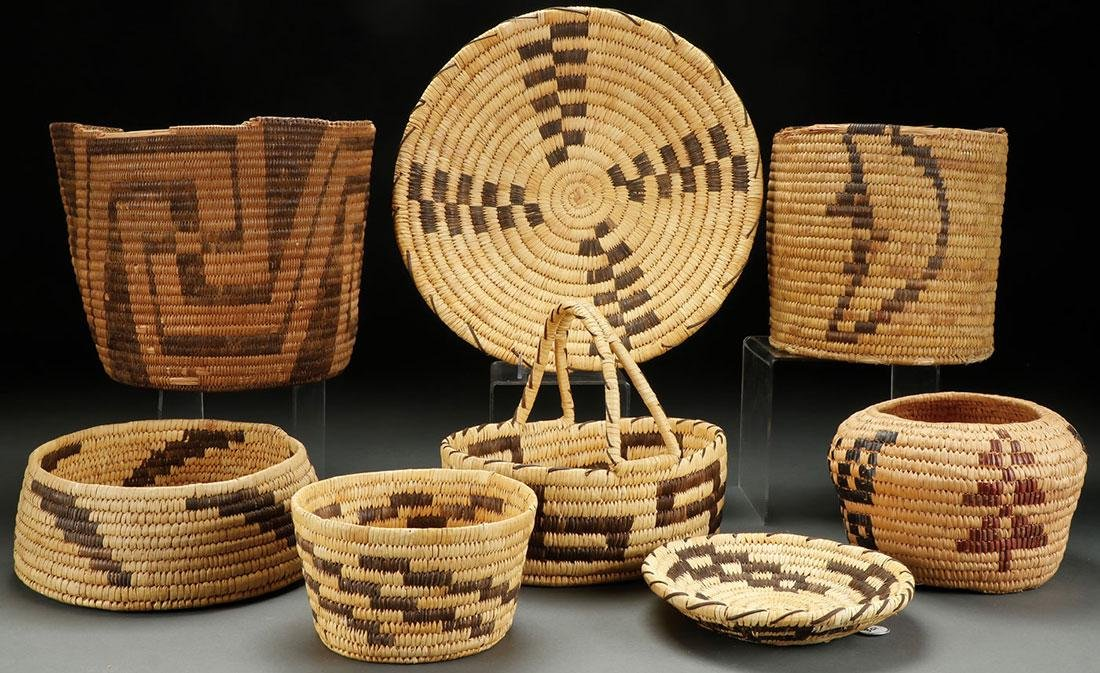 A GROUP OF EIGHT SOUTHWEST WOVEN BASKETRY ITEMS