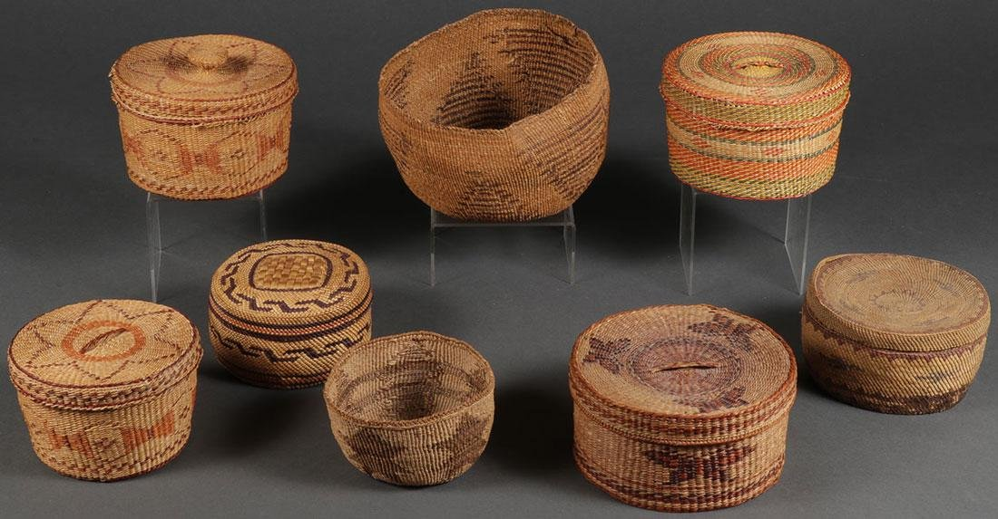 EIGHT WOVEN BASKETS, CIRCA 1910 AND LATER