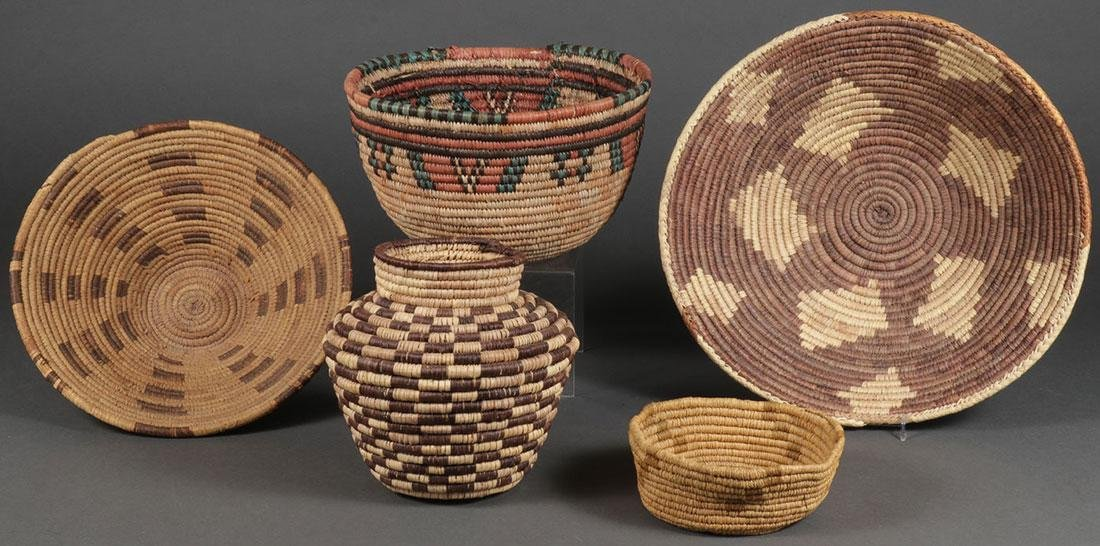 A GROUP OF FIVE WOVEN BASKETS