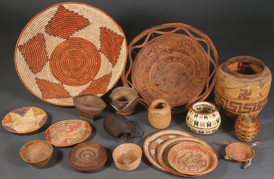 NINETEEN WOVEN BASKETRY ITEMS, CIRCA 1925 & LATER