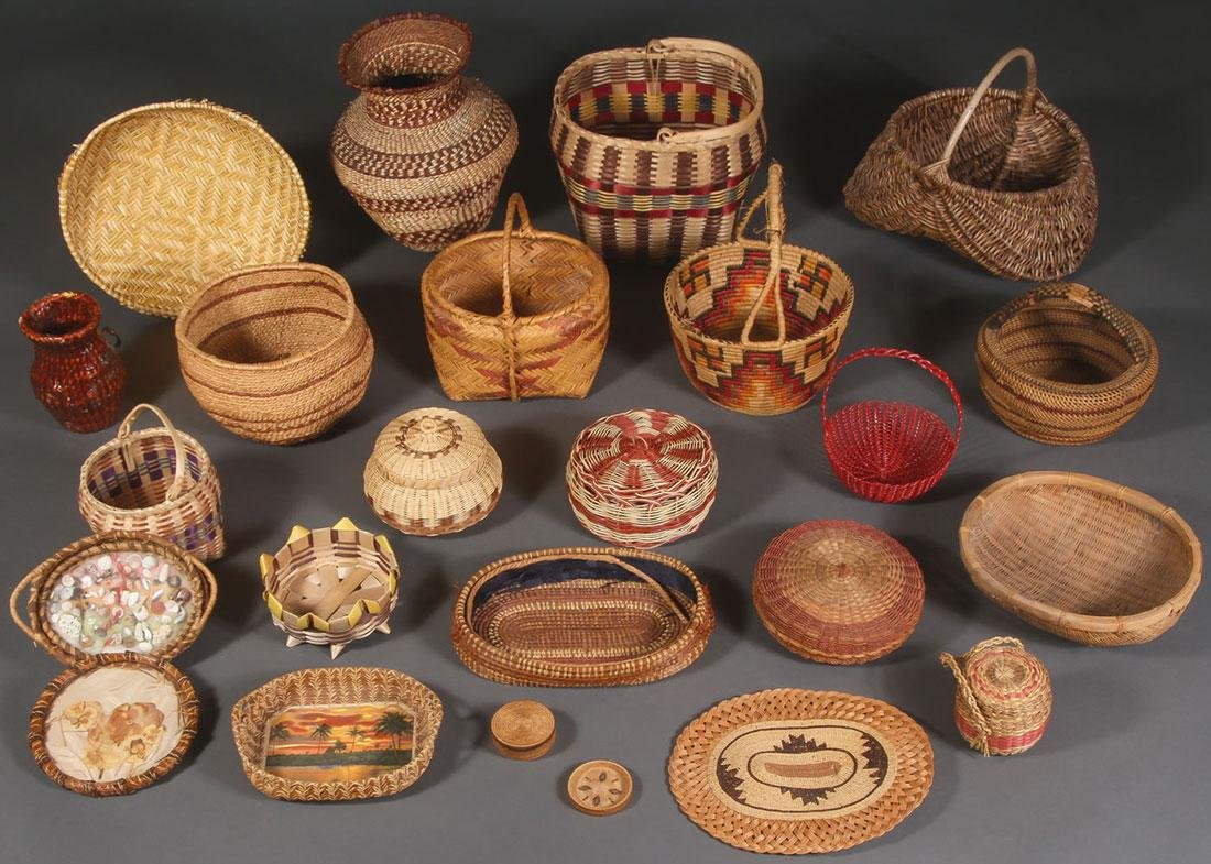 TWENTY-THREE WOVEN BASKETRY ITEMS