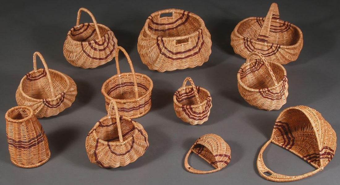 A GROUP OF ELEVEN WOVEN BASKETS