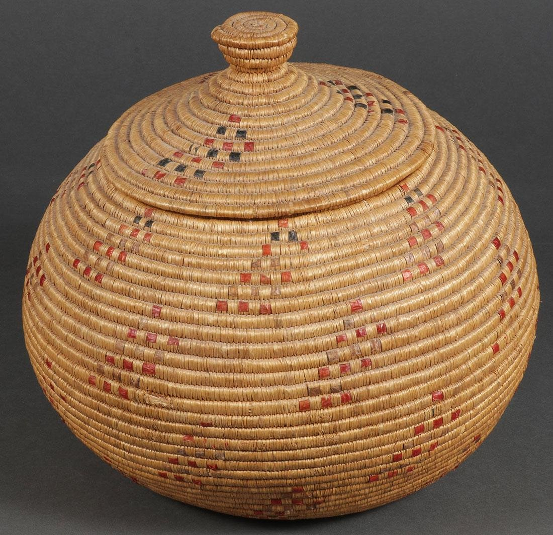 A LARGE AND ATTRACTIVE ESKIMO LIDDED BASKET