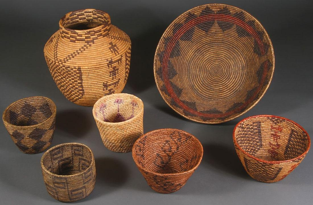 A GROUP OF SEVEN LARGE WOVEN BASKETS