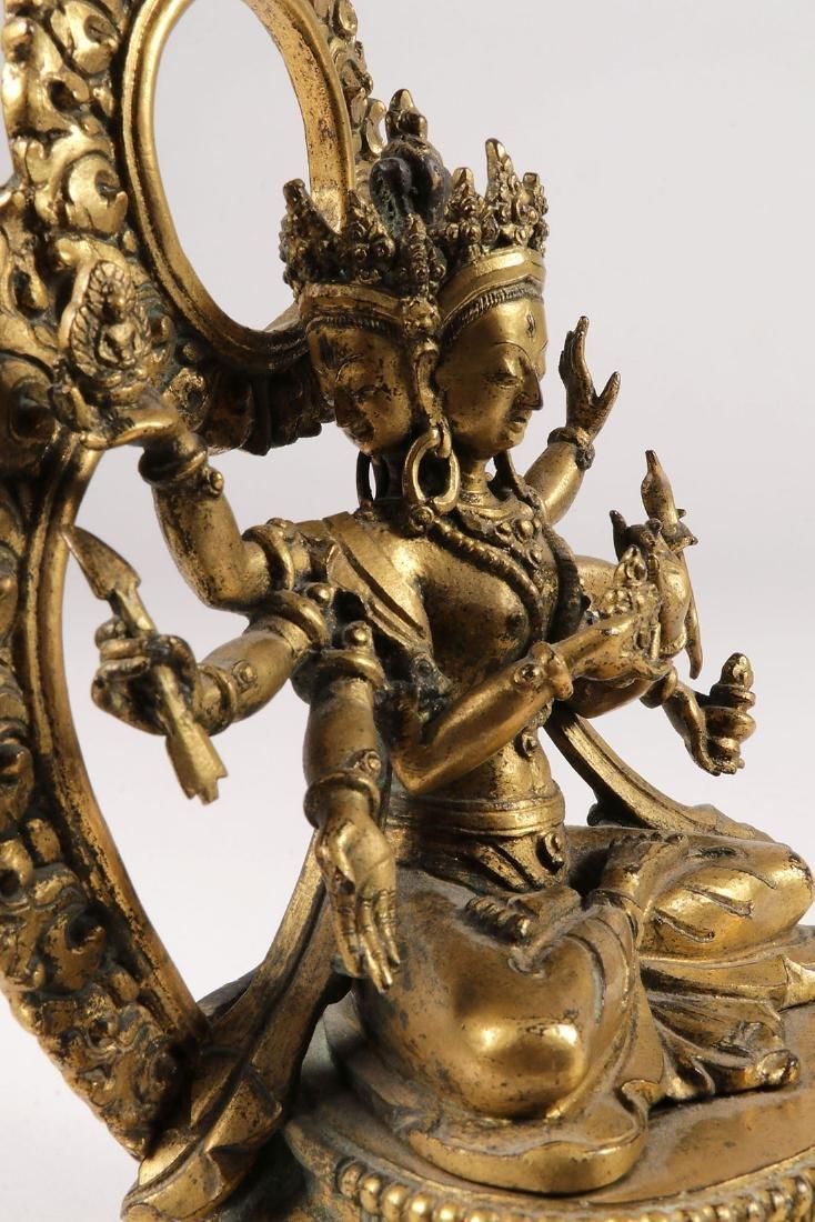 A FINE GILT BRONZE FIGURE OF A BUDDHIST DEITY - 10