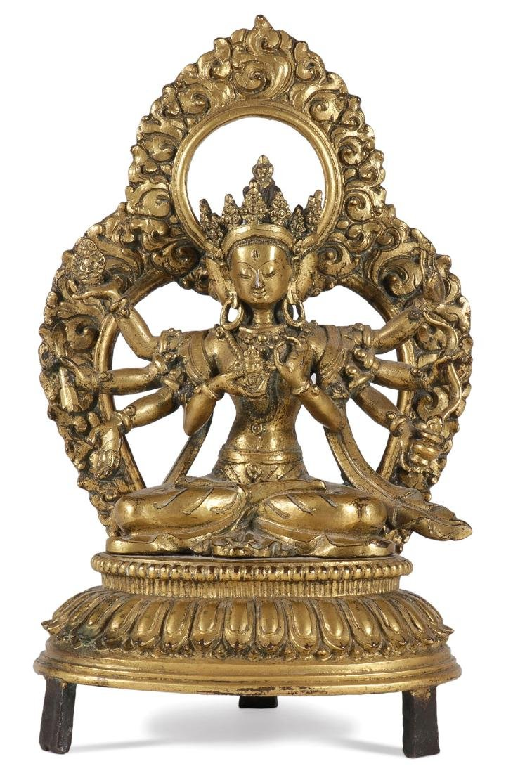 A FINE GILT BRONZE FIGURE OF A BUDDHIST DEITY