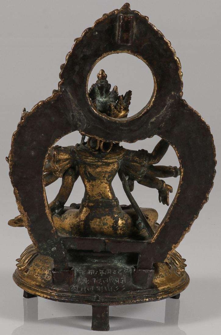 A FINE GILT BRONZE FIGURE OF A BUDDHIST DEITY - 2