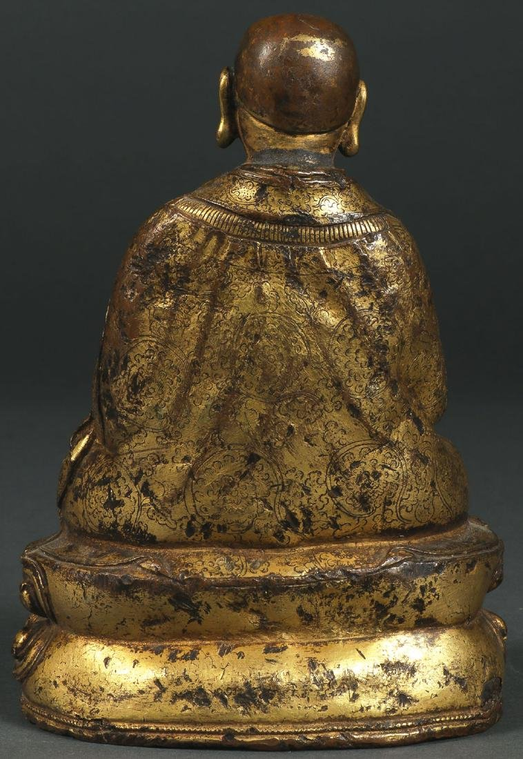 A SINO-TIBETAN GILT COPPER FIGURE OF A MONK - 2