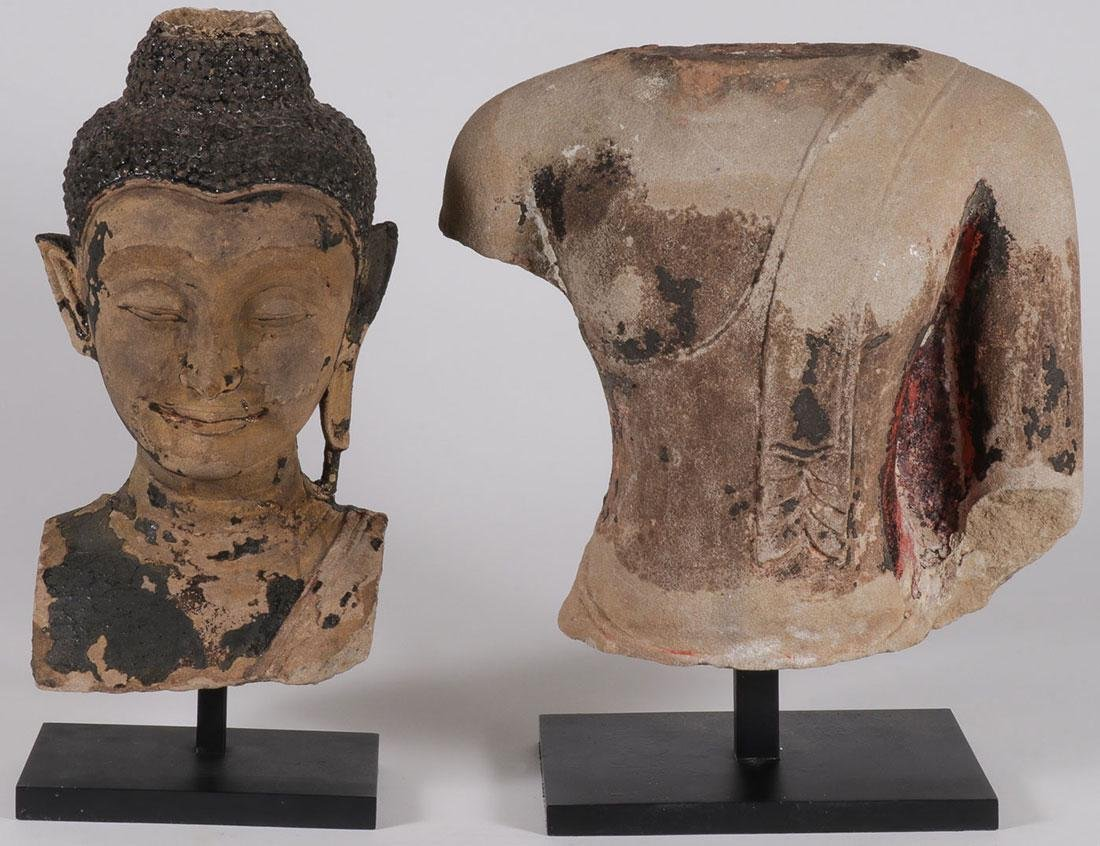 A CARVED SANDSTONE HEAD AND TORSO OF BUDDHA