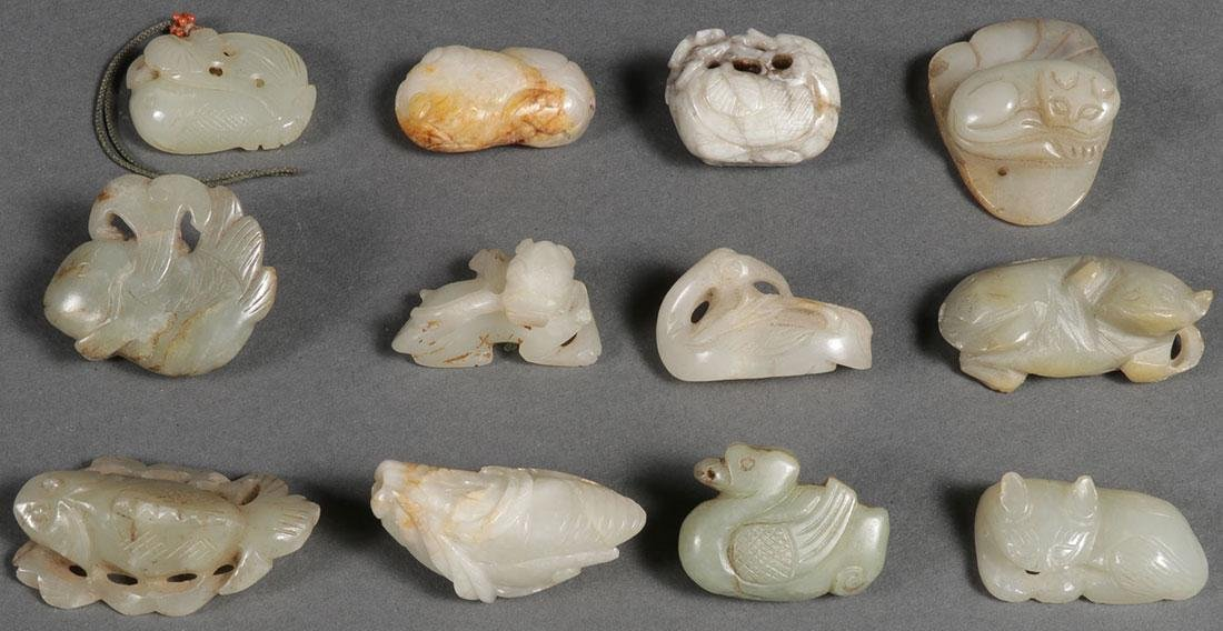 A GROUP OF TWELVE CHINESE CARVED JADE PENDANTS