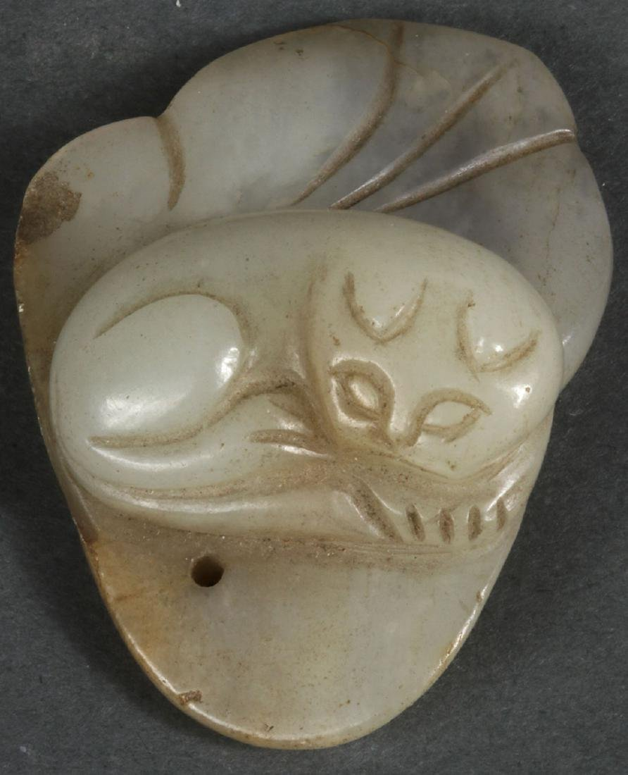 A GROUP OF TWELVE CHINESE CARVED JADE PENDANTS - 2