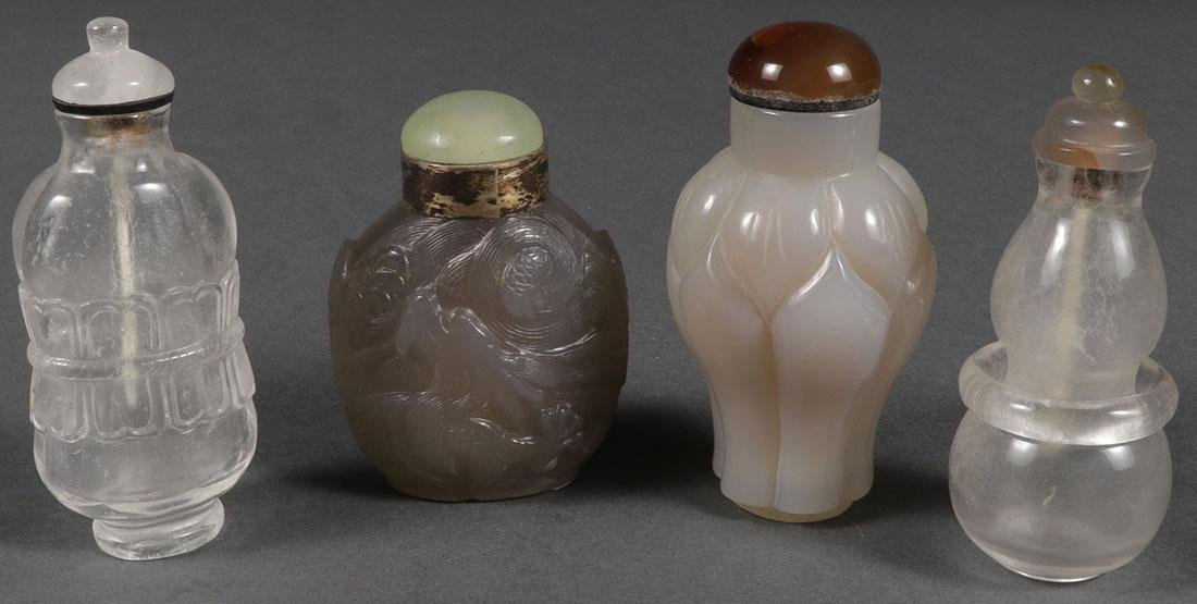 FOUR CHINESE CARVED SNUFF BOTTLES