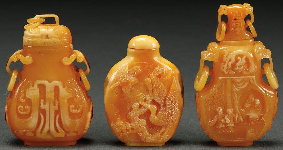 THREE CHINESE CARVED HORNBILL SNUFF BOTTLES