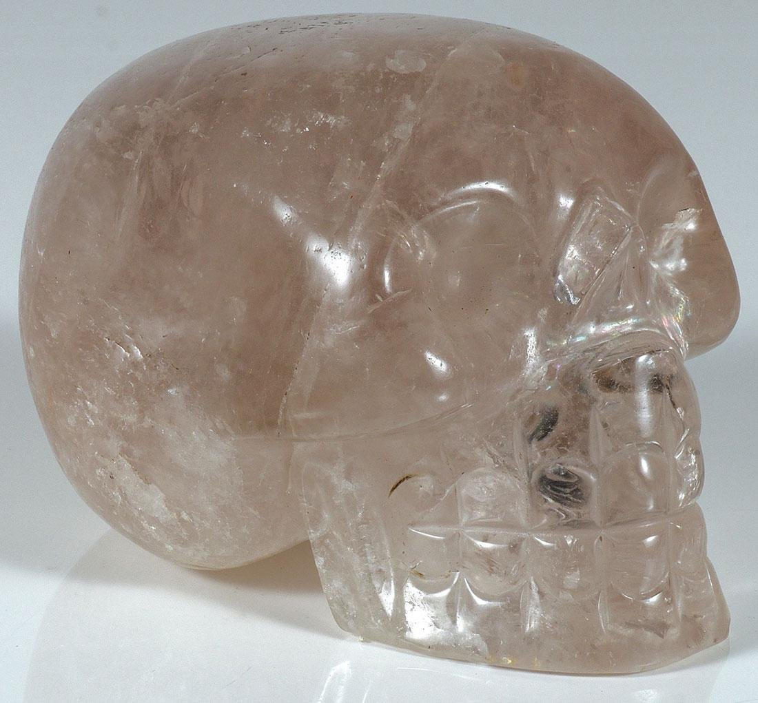 A CARVED QUARTZ CRYSTAL SKULL, PROBABLY CHINESE
