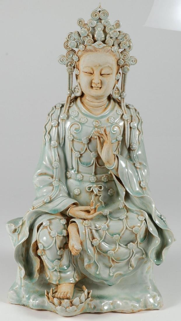 A CHINESE PORCELAIN SEATED BUDDAH