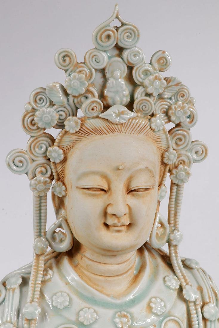 A CHINESE PORCELAIN SEATED BUDDAH - 2