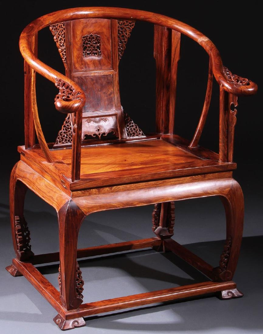 A CHINESE CARVED ELMWOOD ARM CHAIR
