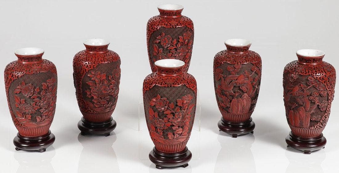 SIX CHINESE CARVED CINNABAR VASES