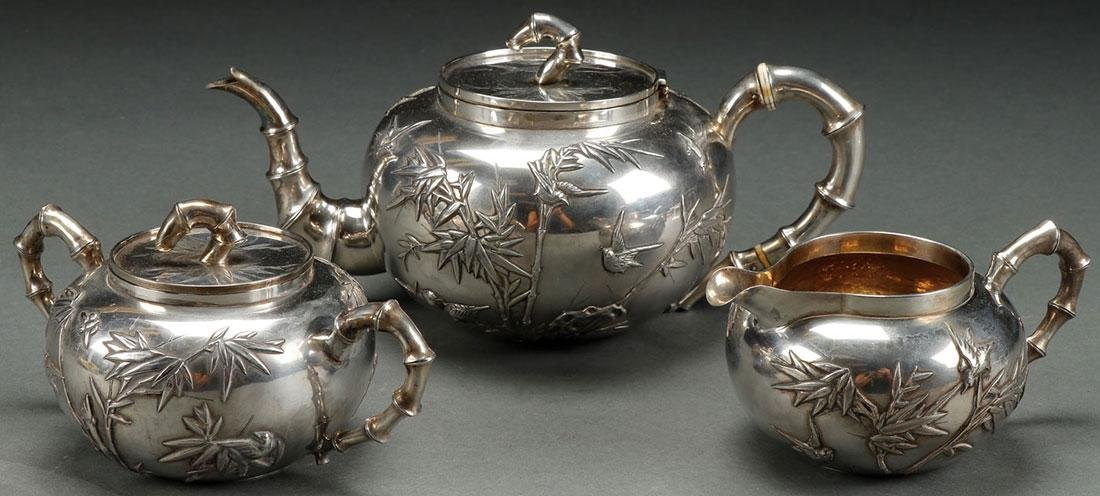 A 19TH C. CHINESE THREE PIECE SILVER TEA SET
