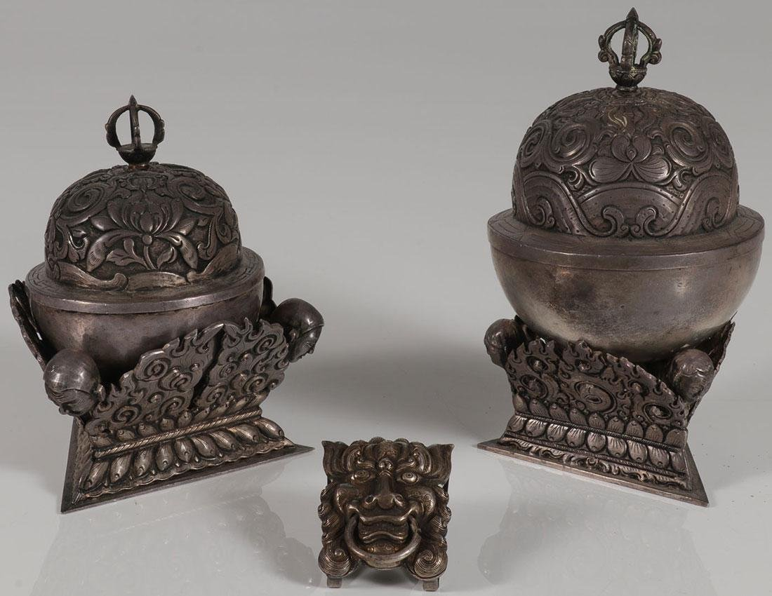 A PAIR OF TIBETAN SILVER COVERED VESSELS