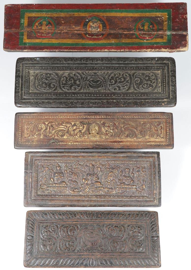 5 TIBETAN CARVED POLYCHROME AND GILT SUTRA COVERS