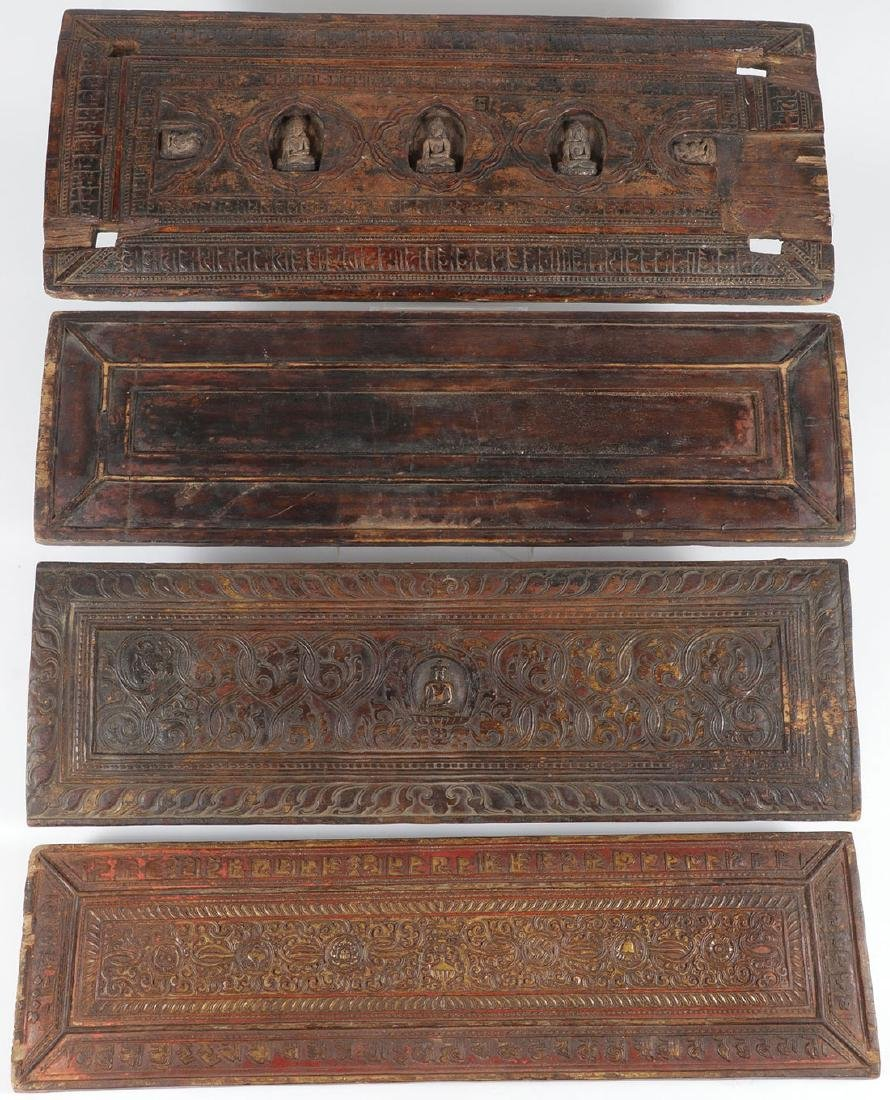 FOUR TIBETAN CARVED WOOD SUTRA COVERS
